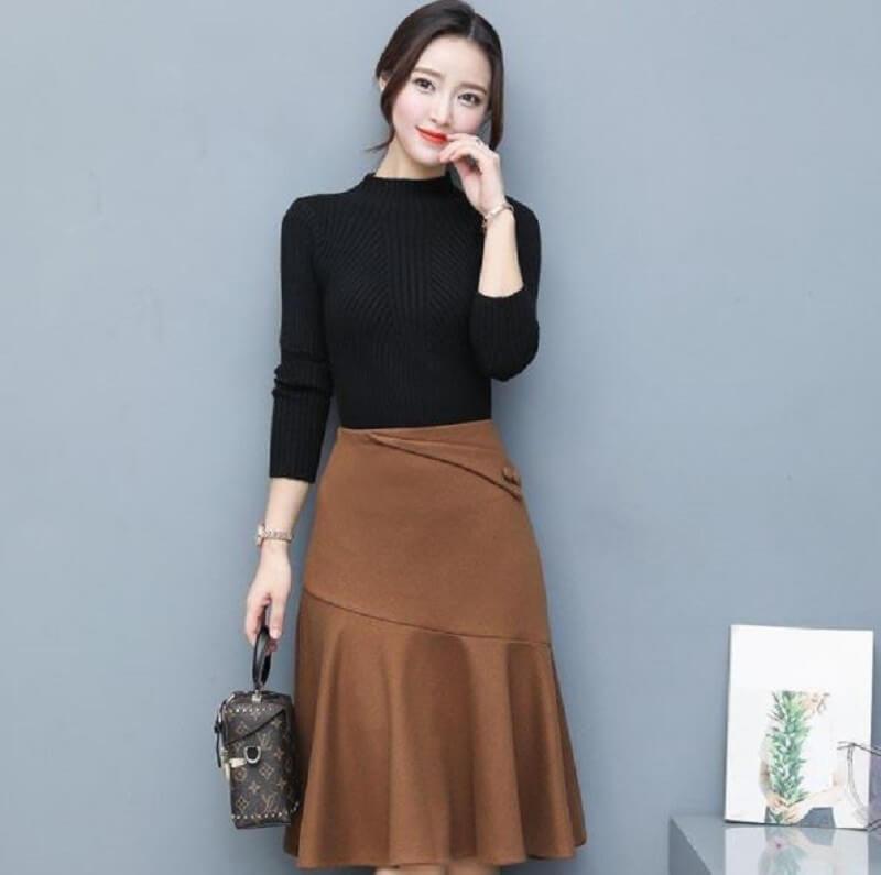 Nhẹ nhàng với áo đen và chân váy màu be